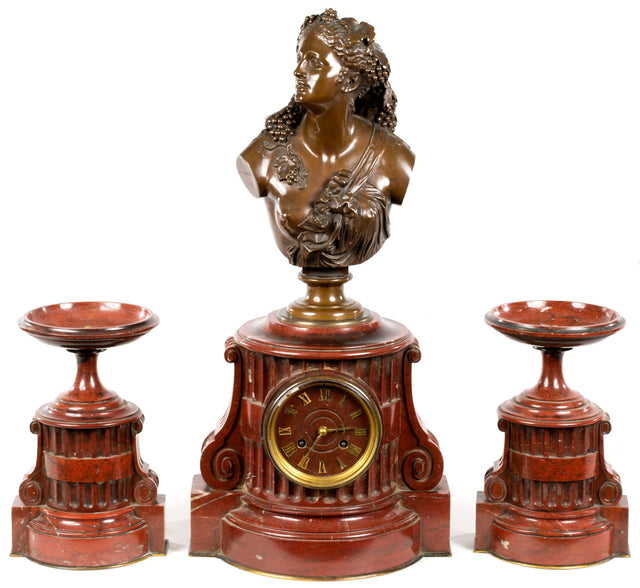 A French Rouge Griotte Mantle set by Barbedienne