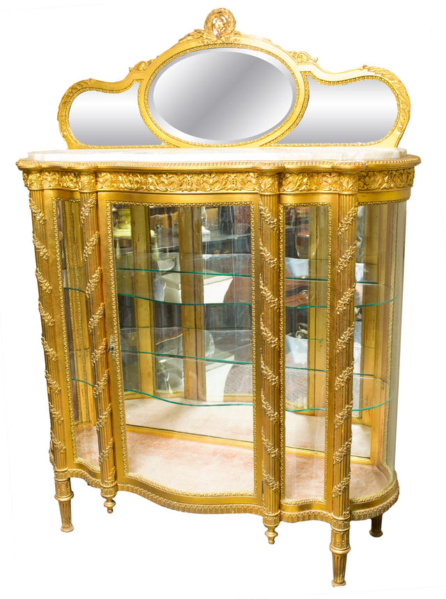A Gilt Napoleon III Vitrine with Curved Glass Sides