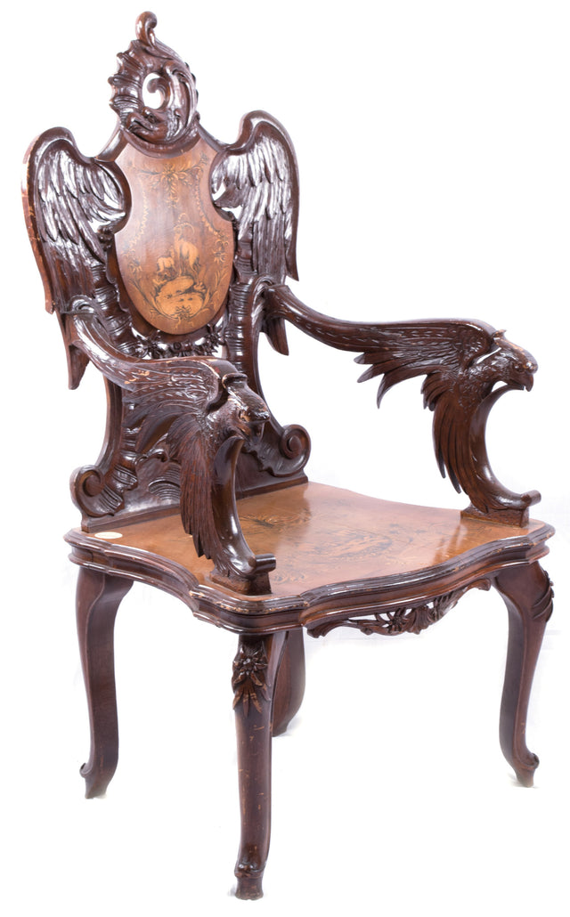 A Black Forest Carved Walnut and Fruitwood Armchair