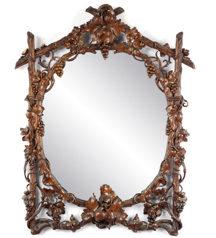 A Black Forest Grapevine Carved Walnut Mirror