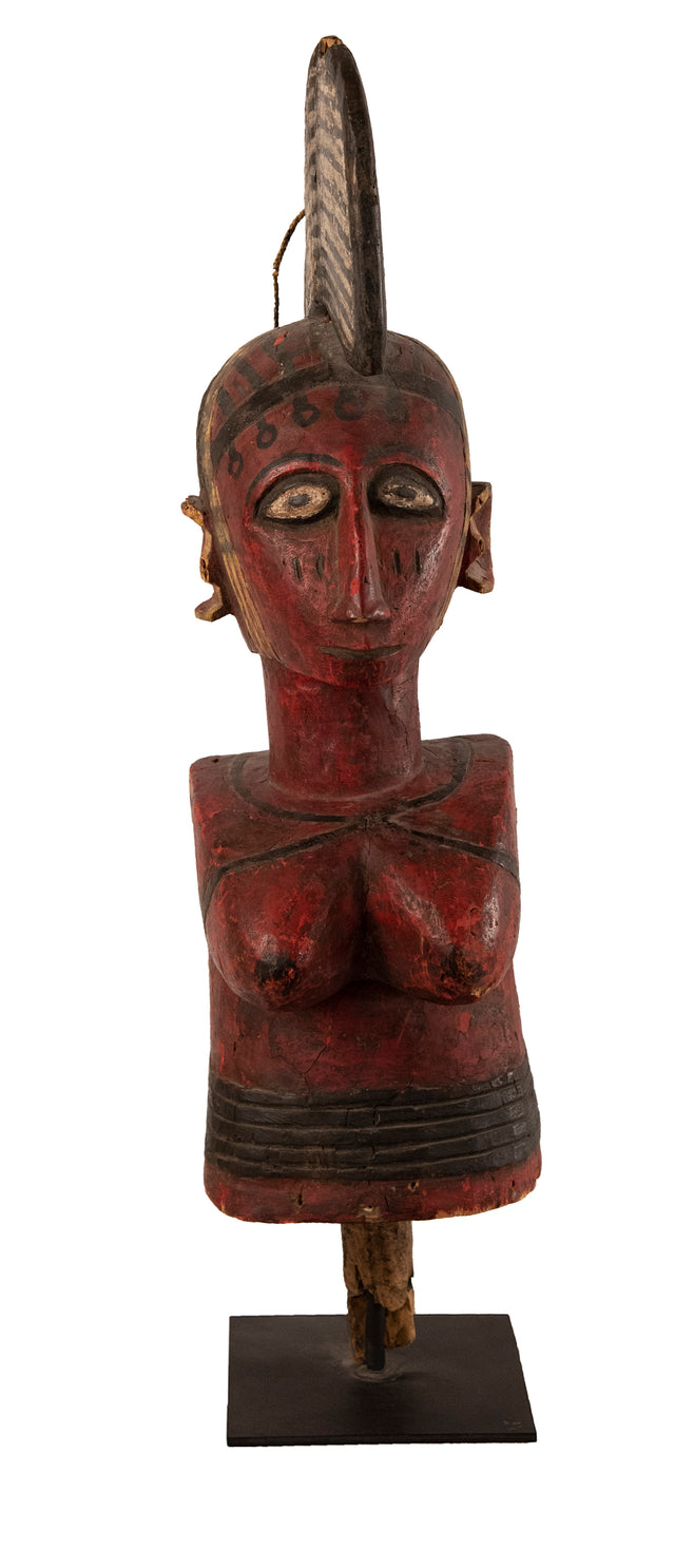Ivory Coast Baule female ancestral figure in carved red and black polychromed wood on a metal stand