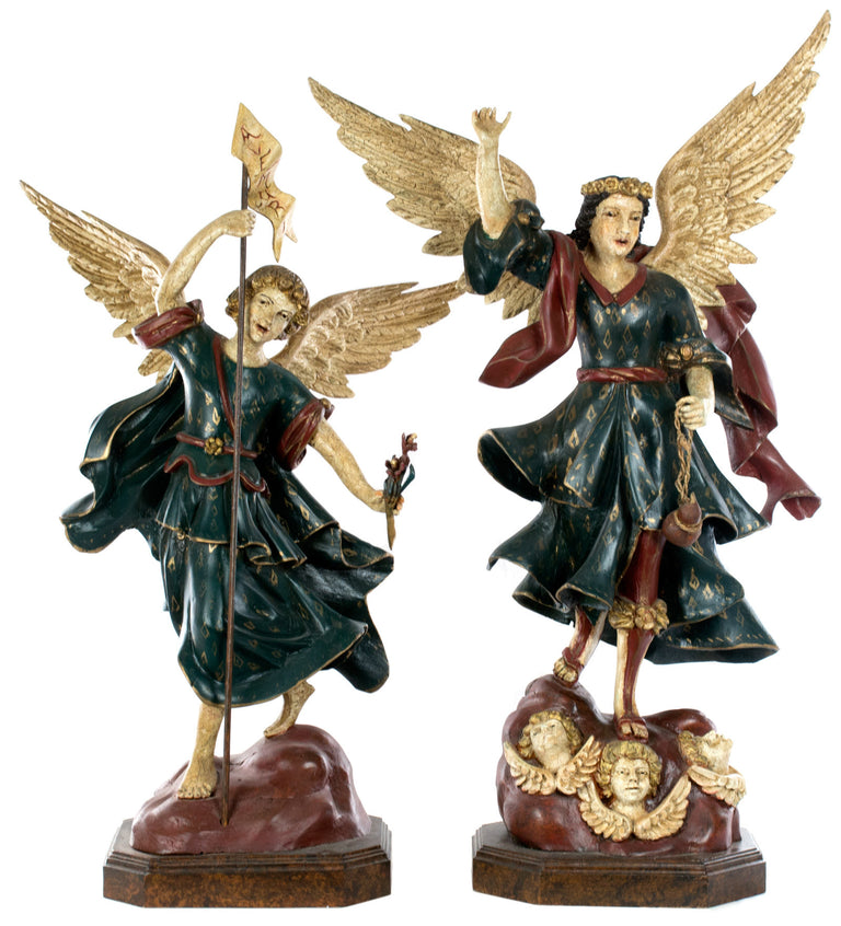 A Pair of Large Statues of Angels on Stands