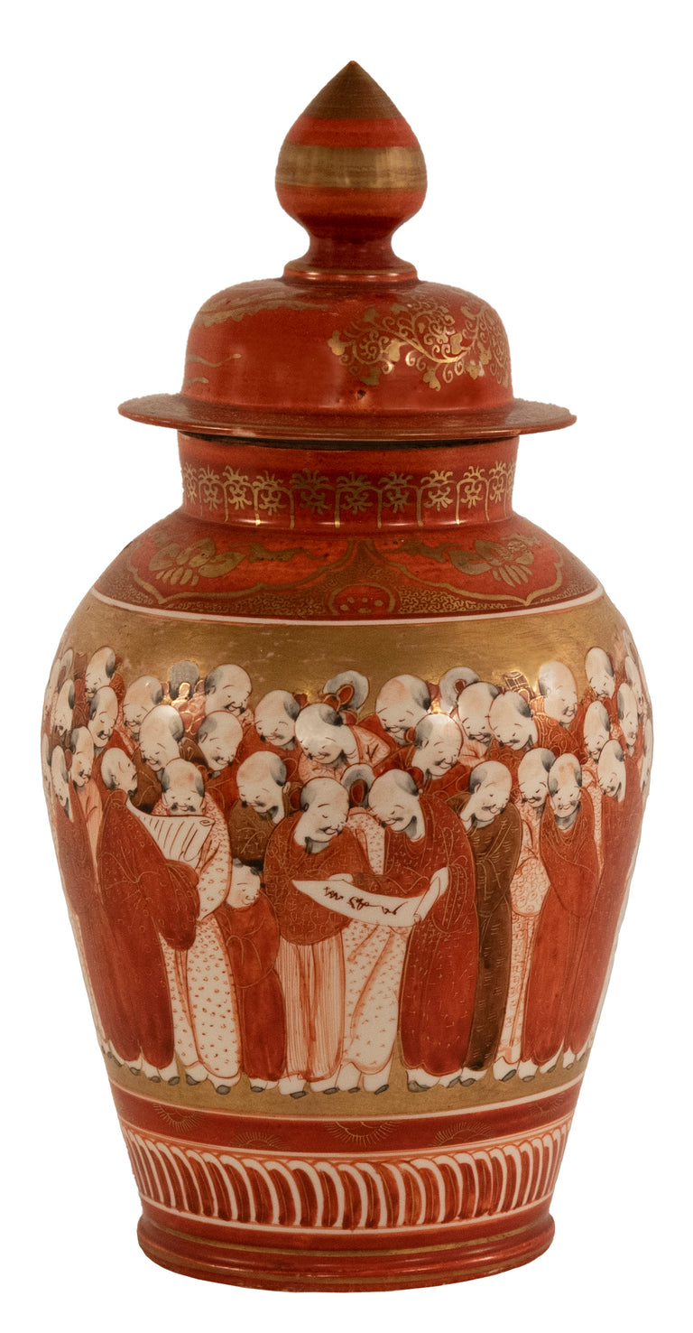 A Japanese baluster vase with exquisitely painted scholarly figures in gold and red manganese with a finial-topped cover
