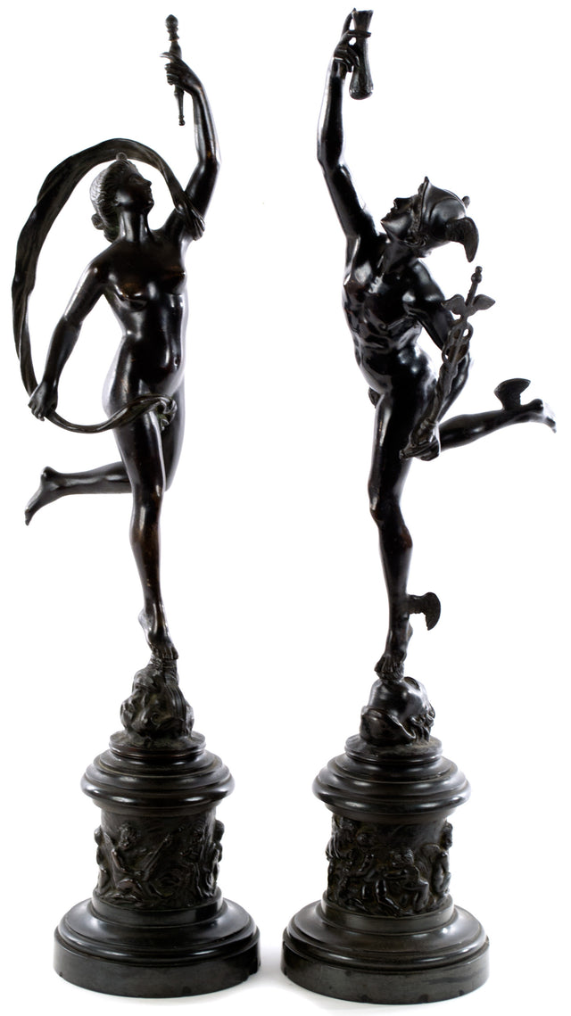 A pair of bronze statues of Mercury and Venus