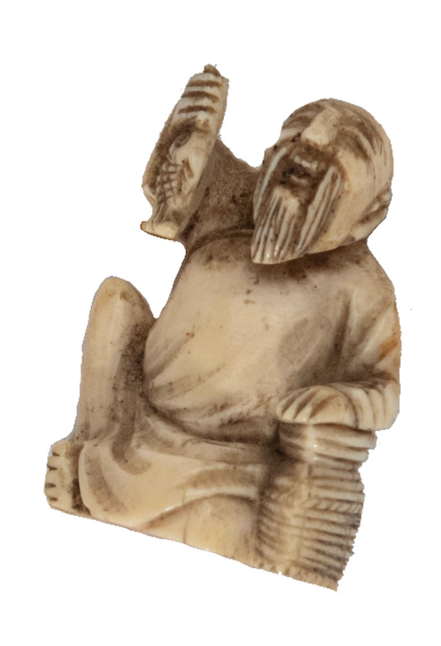Netsuke of Man Holding a Fish