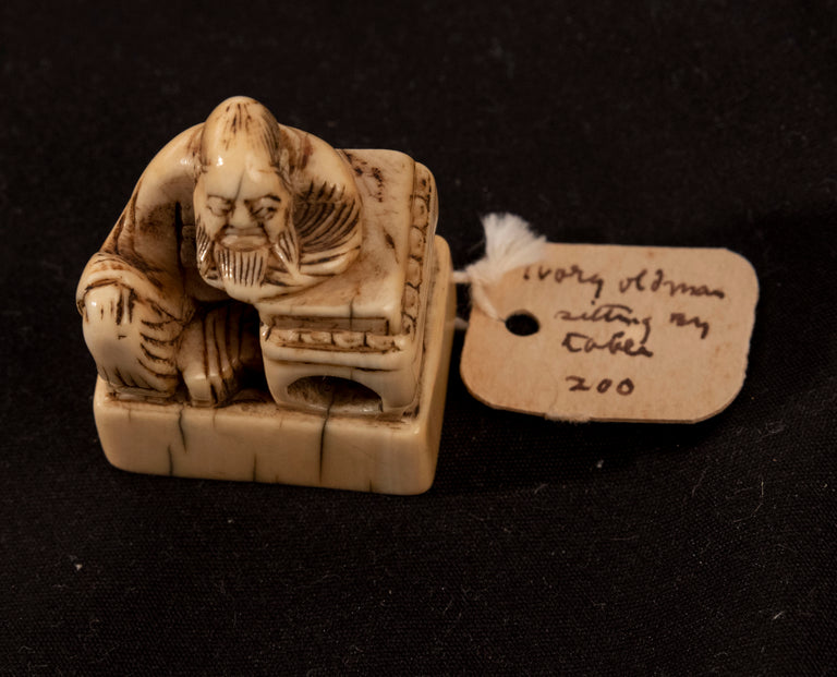 Netsuke of an Old Scholar at a Desk