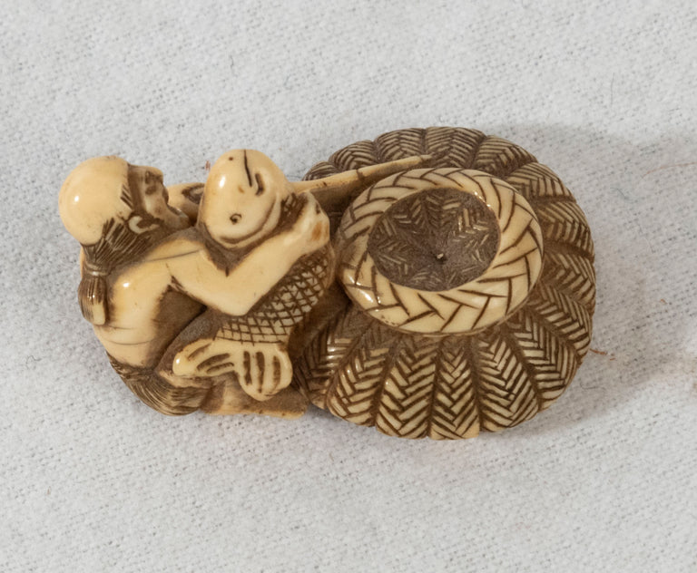 Netsuke of Fisherman with Basket