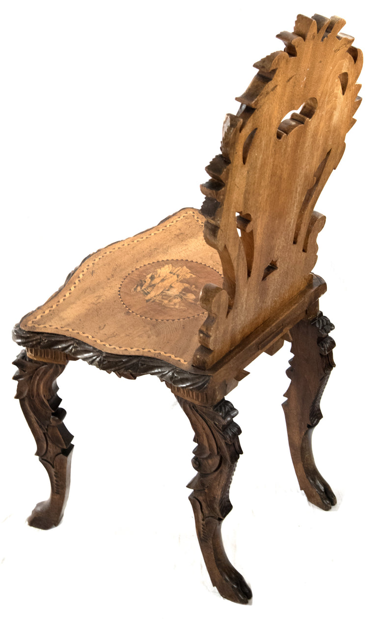 Swiss Black Forest Carved Marquetry Tilt-top Table and Chairs