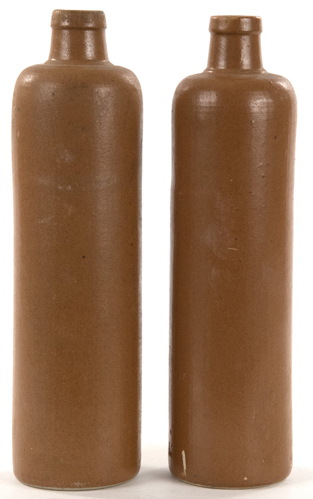 A Pair of Elongated Brown Glazed Stoneware Bottles