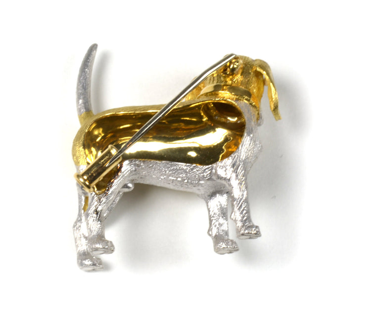 18 karat yellow and white gold, blue sapphire and diamond dog pin