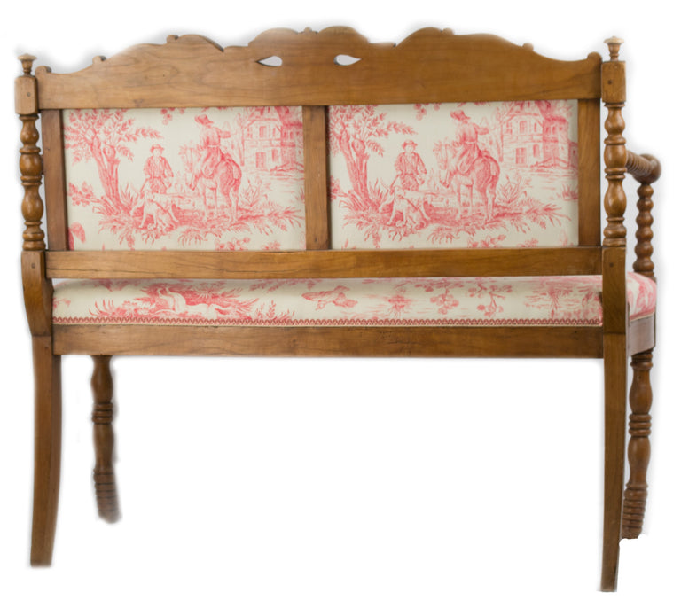 A French Country Directoire-style Settee in Carved Cherrywood