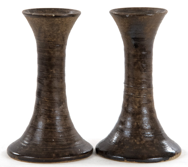 A Set of Brown Glazed Stoneware Candlesticks