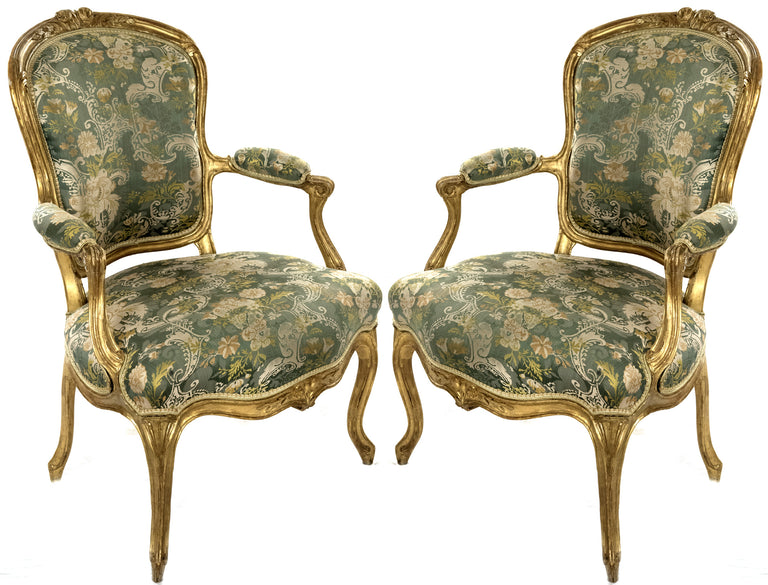 A Pair of Louis XV Carved Giltwood Fauteuils