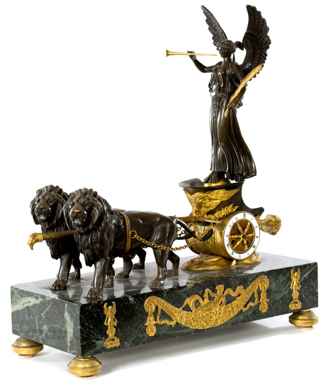A Napoleon III French Empire Style Bronze and Ormolu Mantle Clock with Victory Pulled by Lions