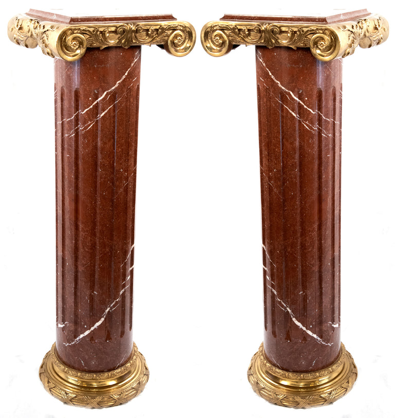 Pair of marble and ormolu pedestals in the form of an Ionic pillar