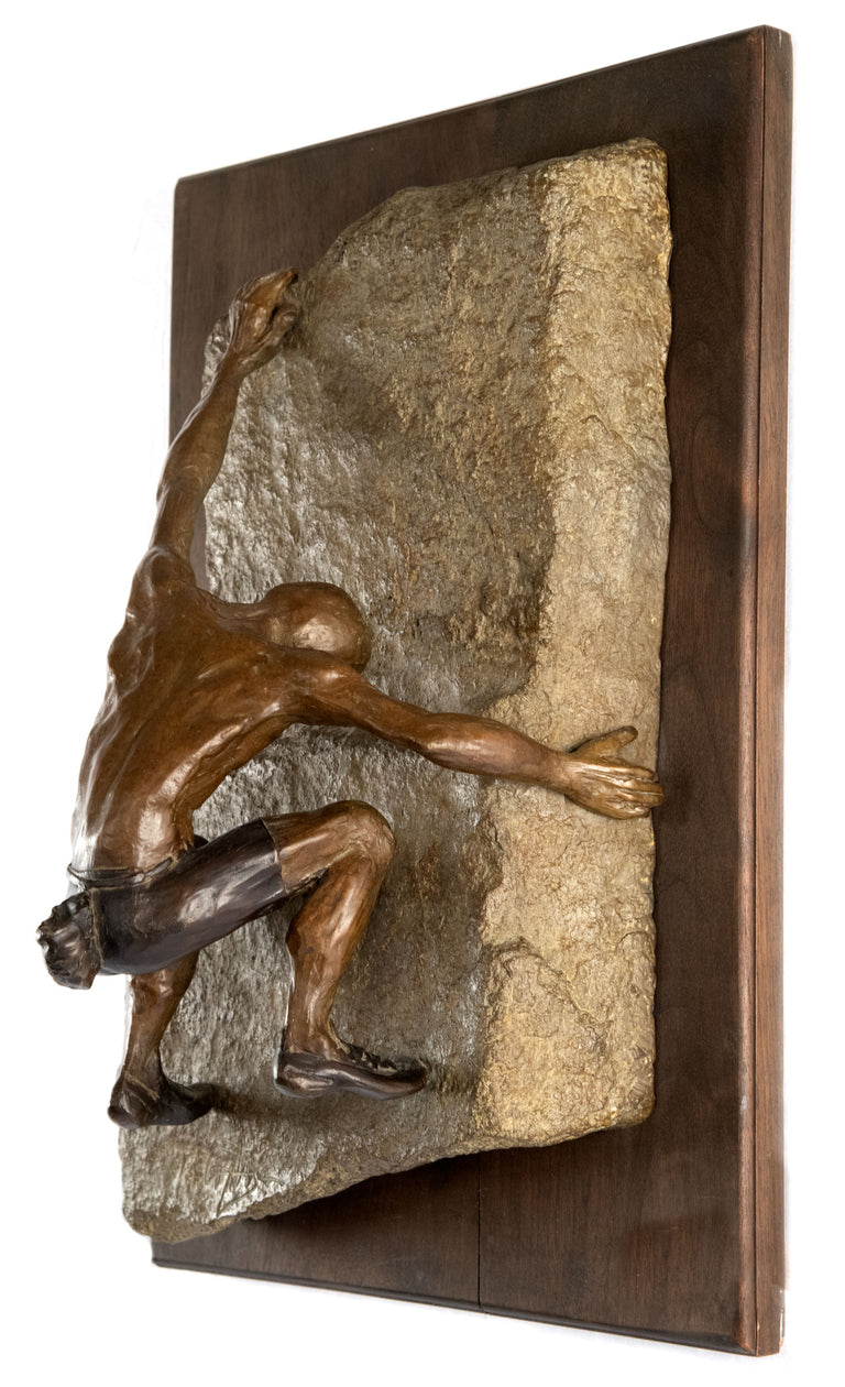 A Bronze Wall Sculpture of a Rock Climber