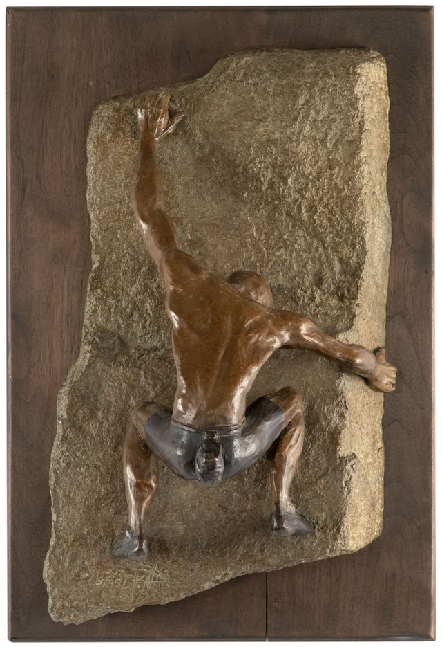 A Bronze Wall Sculpture of a Rock Climber by Jim Rennert