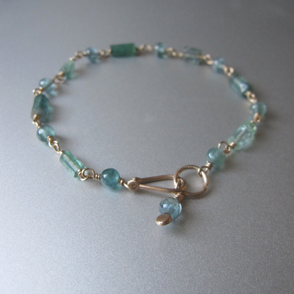 Paraiba blue tourmaline solid 14k gold beaded bracelet