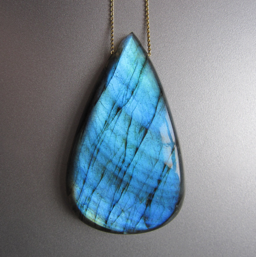 large blue labradorite drop with side stone accent solid 14k gold necklace
