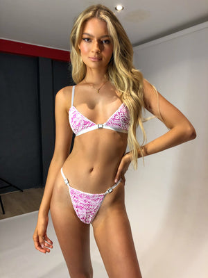 Pink and white lace lingerie set. Bralette and G-string feature silver diamonte buckles