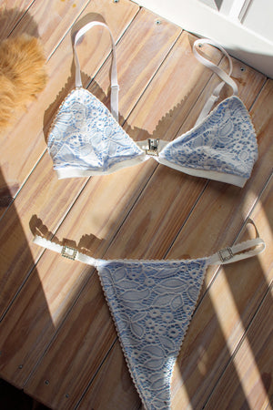 Light blue bralette with white lace and diamonte buckle and G string with diamonte buckles