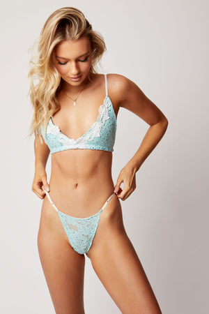 Pastel mint coloured bralette with white lace edging and matching lace g-string