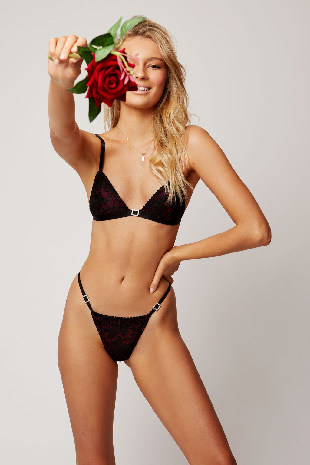 Red and black bralette with black lace and diamonte buckle, matching g-string