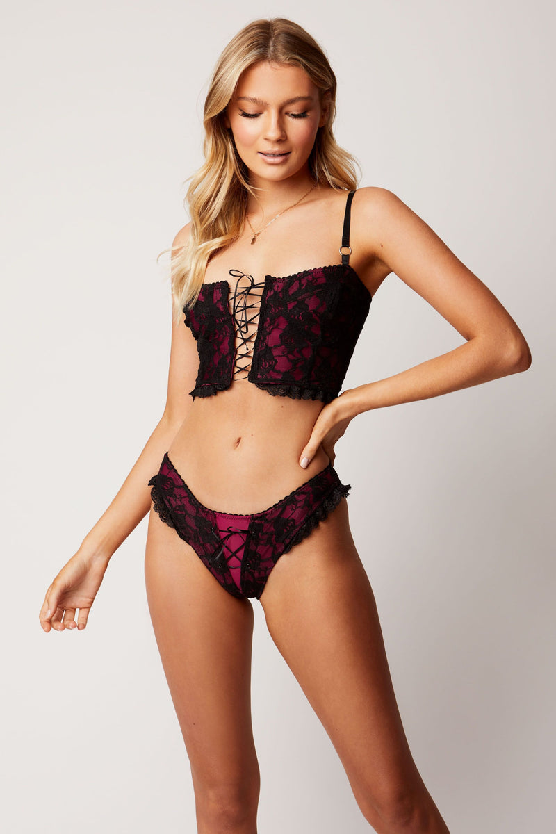 black lace with red undertones. Lingerie corset and lace up knickers