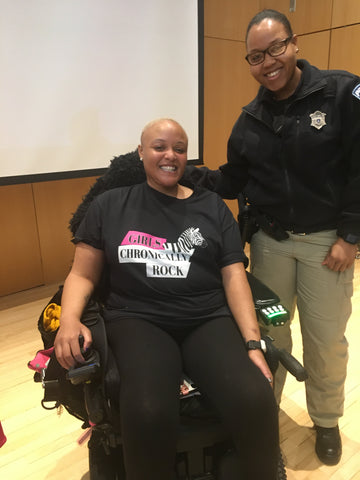 Keisha Greaves with person at Framingham State