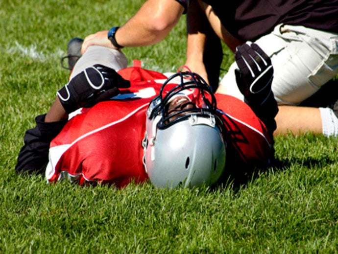 Football players tackle injury with Massage Therapy