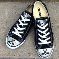 Women's black low top Converse shoes with image of blinged hockey sticks and a hockey puck