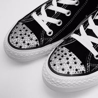 Black Converse shoes with clear and black rhinestones blinged on the toes. Tricked Kicks