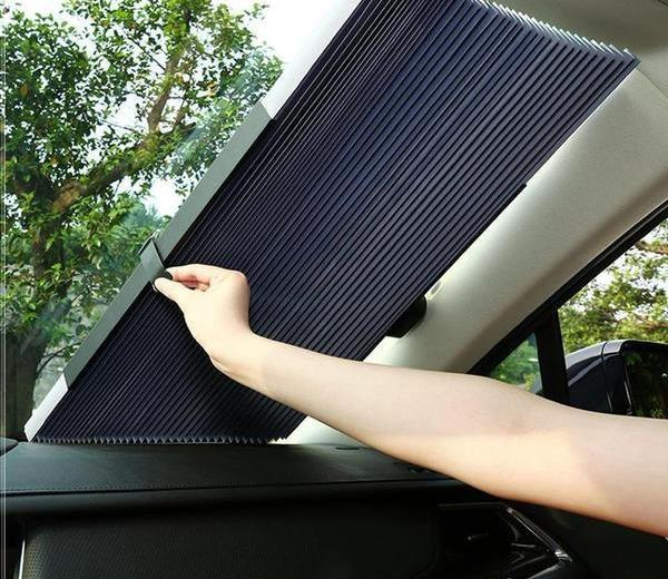 Retractable UV protection windshield blind