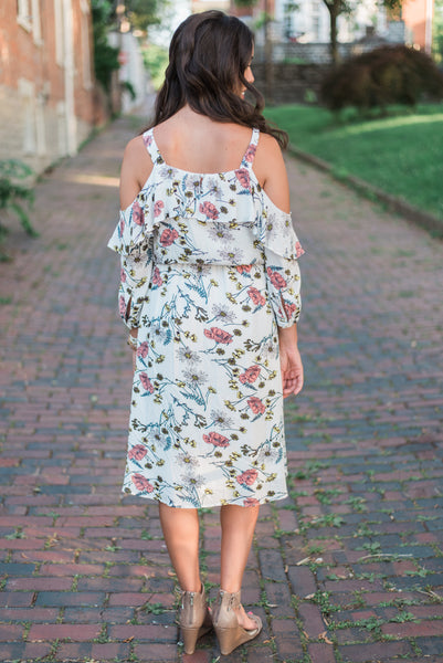 Cold-shouldered, cutout sleeve, ruffled back, floral print. The Olivia Dress.