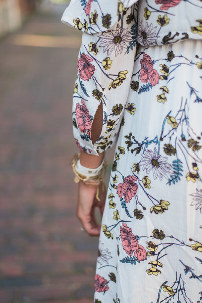Ruffled sleeve, cutout detail, floral print. The Olivia Dress.