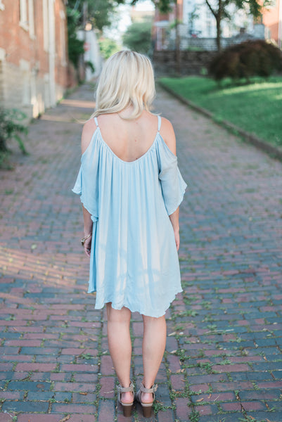 Open-shoulder, scooped back, dusty blue. The Sophie Dress.