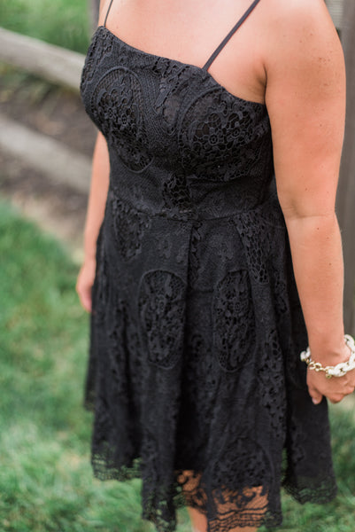 Black, all-over lace, a-line, adjustable spaghetti strap. Stella dress