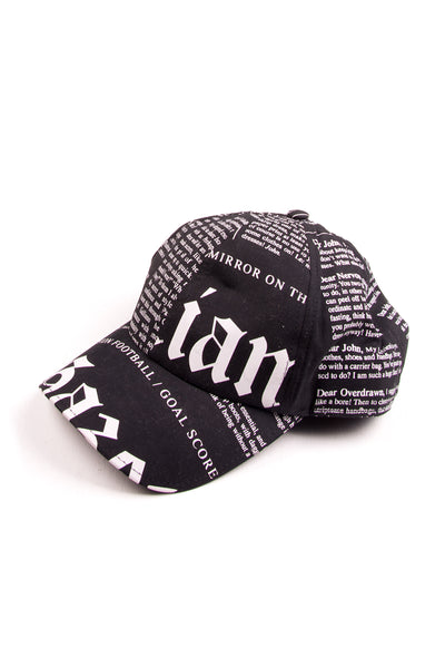 John GallianoNewspaper Print Cap in Black- irvrsbl