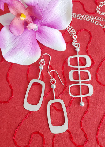 Set of Googie style sterling silver earrings and necklace