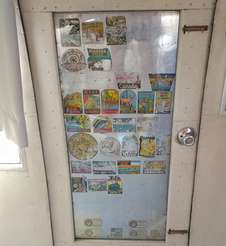Lots of vintage stickers on the door of the 1956 Airstream trailer motel in Wildwood NJ