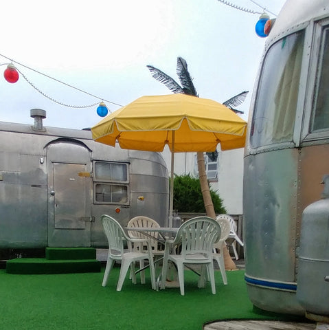 Plastic tables and chairs by the Airstream trailers in Wildwood NJ