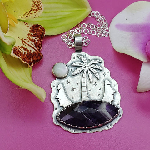 Sterling silver tiki necklace featuring moai heads, palm trees and chevron amethyst