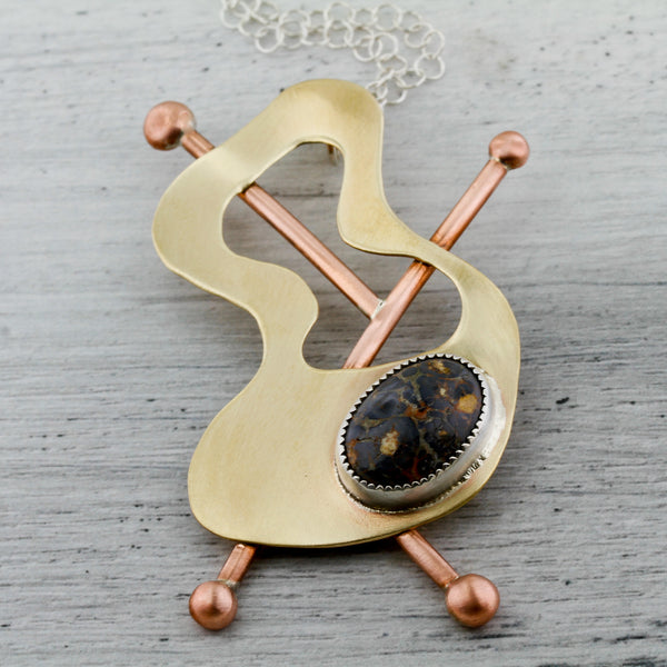 Whimsical abstract brass, copper necklace with leopardskin jasper inspired by modernist jewelery, Frank Rebajes.