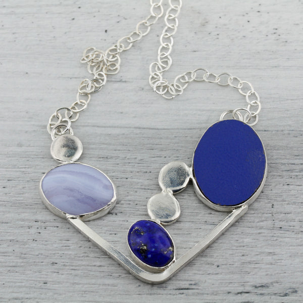 Blue lace agate, lapis lazuli, and laminate on wood modernist abstract necklace.
