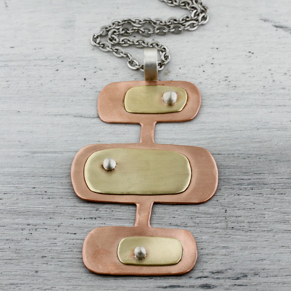 Triple decker rectangle necklace in copper and brass necklace.
