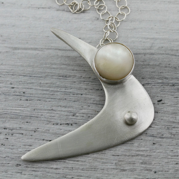 Boomerang sterling silver necklace with mother of pearl