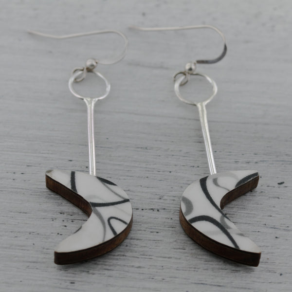 White and black boomerang laminate on wood earrings inspired by mid century modern design.