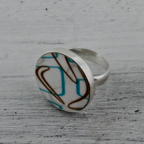 Modernist boomerang laminate on wood ring in turquoise and brown
