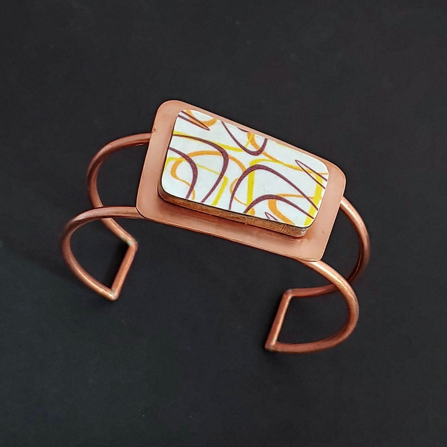 The Marquee Boomerang Laminate Bracelet - Orange/Yellow