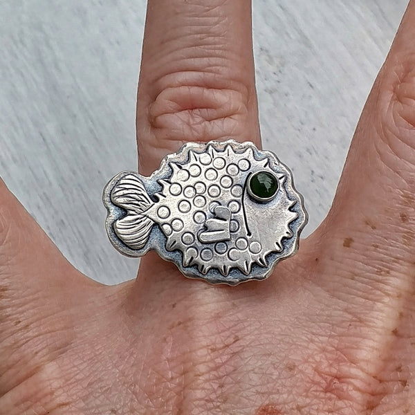 Sterling silver puffer fish ring shown on ring finger